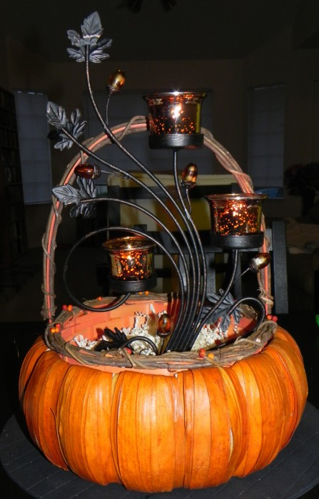 Pumpkin centerpiece with tealight candle holders