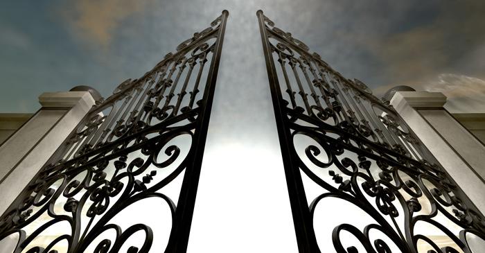 scrolled iron gates opening, shot from below